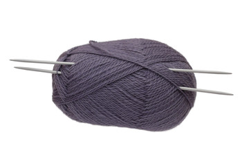 The lilac clue with knitting needles isolated