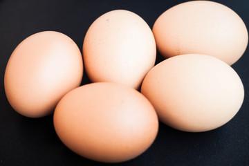 Organic chicken eggs in a black tray