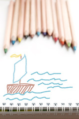 Colored pencils and sketch pad