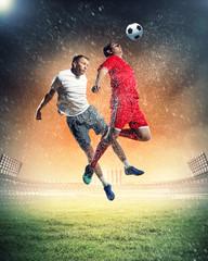 Foto auf AluDibond Fußball two football players striking ball