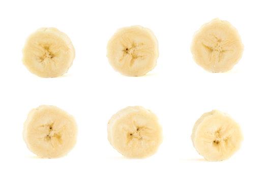 Six banana slices set over white background