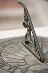 Sundial with Roman Numerals in a Garden