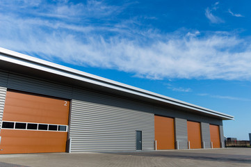 new storage warehouse with brown doors Wall mural