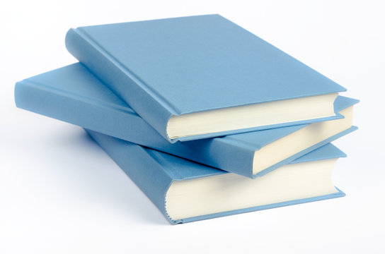 Three blue books on a white background