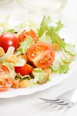 Close-up of salad. Lettuce, tomato, cucumber. Selective focus