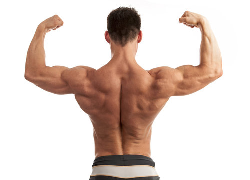 Rear view of a young man flexing his arm and back muscles