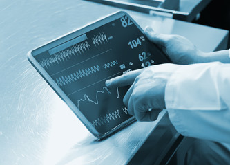 Doctor Using Digital Tablet with medical parameters