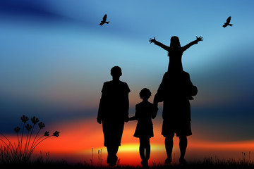 Family with children walk on a sunset
