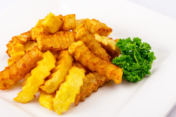 fried sliced ​​curly sticks potatoes