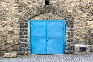stone wall with blue door