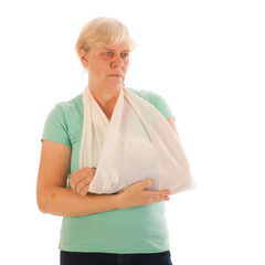 Old woman with broken wrist in gypsum