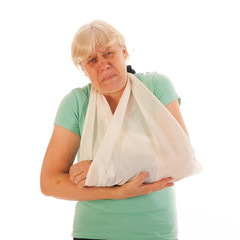 Old woman with broken wrist in gypsum and pain