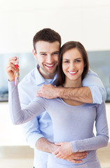 New home owners with key
