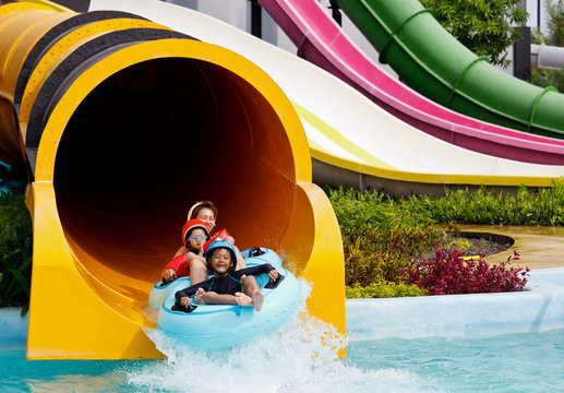 Boy playing in water park
