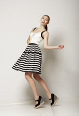 Fashion Style. Happy Shopper in Contrast Striped Grey Skirt
