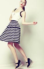 60s Fashion Style. Pretty Stylish Woman in Retro Short Dress