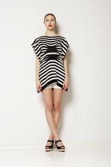 Modern Classy Woman in Grey Elegant Clothing. Crossed Legs