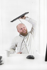 Office worker Strangle Himself with Keyboard Cable
