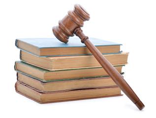 Judge gavel and soundboard on old books