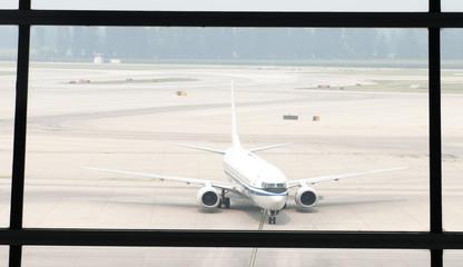Airplane near the terminal in an airport