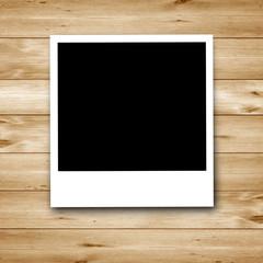 Polaroid auf Holz