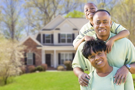African American Family In Front of Beautiful House