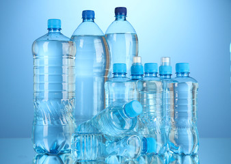 Different water bottles on blue background