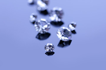 Beautiful shining crystals (diamonds), on blue background