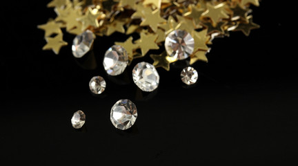 Beautiful shining crystals (diamonds) and golden stars,