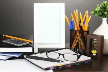 White photo frame on office desk on grey background