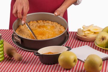 Spreading marmalade on apple pie dough
