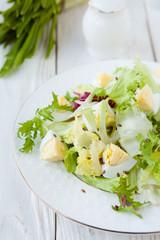 Fresh salad greens with eggs