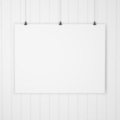 blank paper with clips on wood background