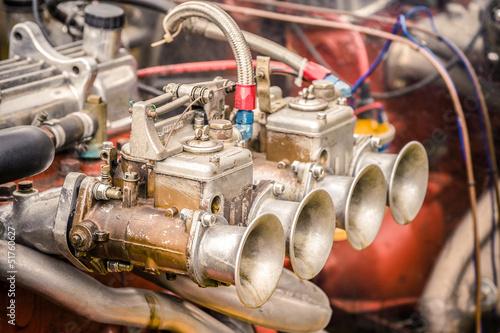 Wall mural vintage muscle car carburetor and engine bay closeup