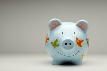 Colourful cermanic piggy bank isolated