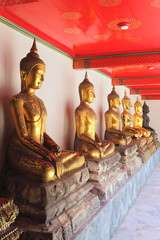 row of buddha sculptures in sitting version