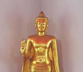 isolation of golden buddha image in stop-fighting style