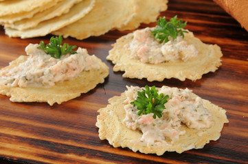 Smoked salmon dip on gourmet crackers
