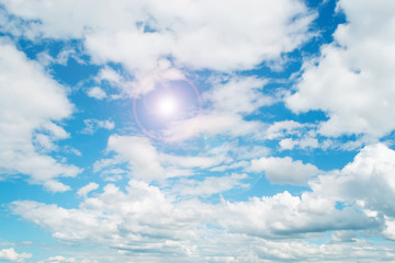 clouds and blue sky with sun