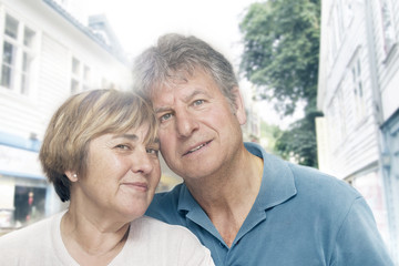 Closeup portrait of happy mature couple enjoying together