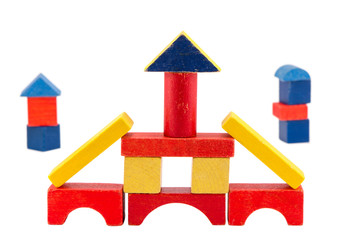 colorful wood toy brick construction on white