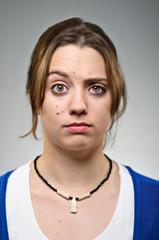 Young Caucasian Woman Raised Eyebrow Portrait