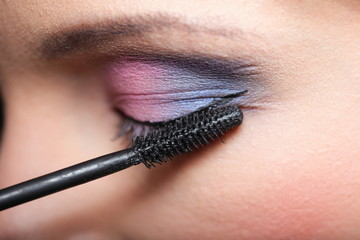 Makeup. Applying Mascara. Long Eyelashes