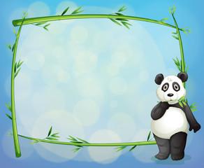 A panda beside a framed bamboo tree