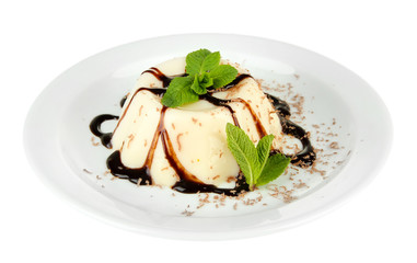 Panna Cotta with chocolate sauce, isolated on white