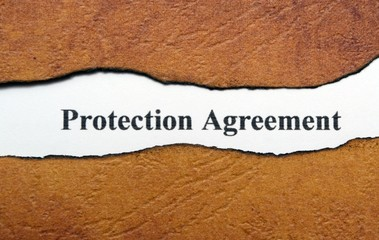 Protection agreement text on torn paper
