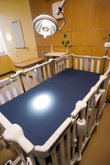 Medical Inspection Light Shines Down Bed Childrens Hospital Room