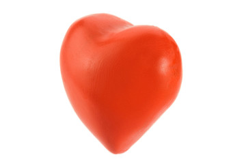 Red heart made of plasticine on a white background