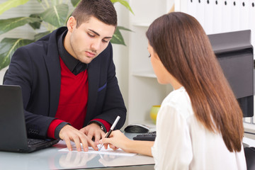 businessman showing a contract to a customer in the office