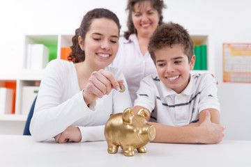 Happy family with piggybank